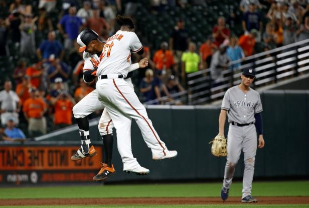 baltimore-orioles-jonathan-schoop-right-and-manny-machado-celebrate-in-front-of-new-york-yankees-fir_125732_